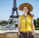 smiling young woman in bright blouse in Paris, France