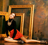 beauty rich brunette woman in luxury interior near empty frames,