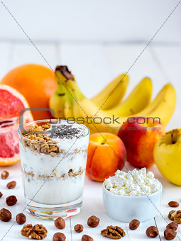 cottage cheese, yogurt, fruits and nuts vertical