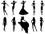 Set of ten female silhouettes over white