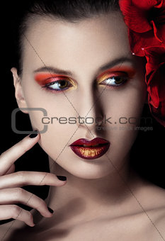 Beauty woman with flowers on black background