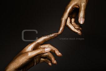 beautiful hands in golden paint
