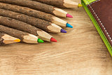 wood colored natural  pencils and leather notebook