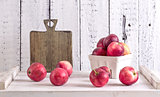 red apples on a wite rustic wood table