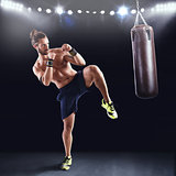 Man  is training with the punching bag