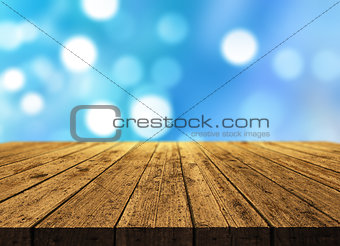 3D wooden table on bokeh lights background