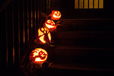Halloween pumpkins on door steps