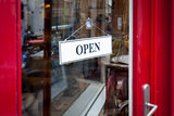 an open sign at the shop door