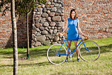 Cheerful young woman and old style bike racing
