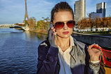 young trendy woman talking on cell phone near Eiffel tower