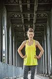 woman jogger standing on Pont de Bir-Hakeim bridge in Paris