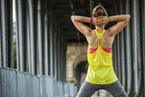 sportswoman stretching on Pont de Bir-Hakeim bridge in Paris