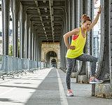 woman jogger relaxing after workout on Pont de Bir-Hakeim bridge