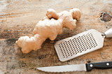 Section of whole raw root ginger on a rustic table