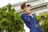 young fashion-monger talking on mobile phone in Paris, France