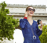 fashion-monger using a smartphone while drinking coffee in Paris