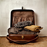 old suitcase with some warm clothing