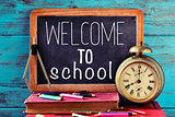 text welcome to school on a chalkboard