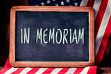 text in memoriam and flag of the United States