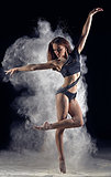 Artistic dance pose using powder or dust