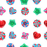 Seamless background with colorful candies on a white background.