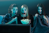Scared teenage watching movies