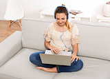 Woman listen music on her laptop