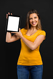 Woman holding and showing a tablet