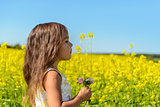 Portrait of a girl in rapeseed field