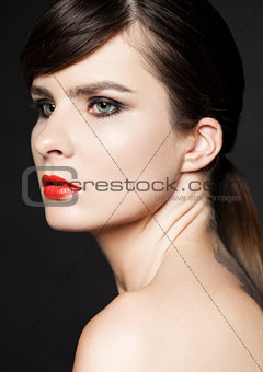 Beauty woman with red lips on black background