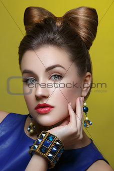 Beautiful girl with makeup and hair bow