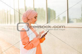 beautiful arabian girl with tablet computer