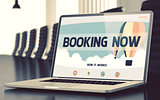 Booking Now Concept on Laptop Screen.