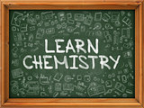 Hand Drawn Learn Chemistry on Green Chalkboard.