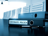 Corporate Policy on Folder. Blurred Image.