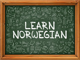 Hand Drawn Learn Norwegian on Green Chalkboard.