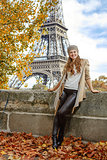 tourist woman on embankment near Eiffel tower in Paris, France
