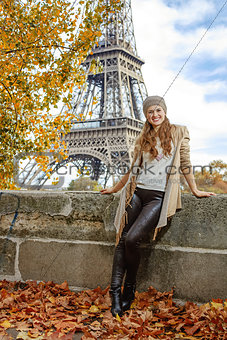 tourist woman on embankment near Eiffel tower in Paris, France