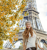 Smiling elegant woman exploring attractions in Paris, France