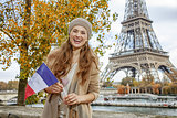 woman showing flag on embankment near Eiffel tower, Paris