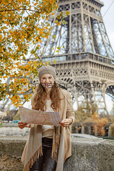 tourist woman on embankment near Eiffel tower in Paris with map