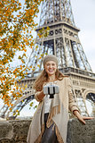elegant woman taking selfie using selfie stick in Paris, France