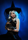 attractive witch with a cat