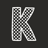 K vector alphabet letter with white polka dots on black background