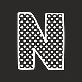 N vector alphabet letter with white polka dots on black background