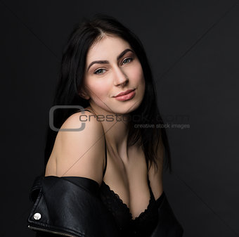 Beautiful brunnette model woman posing in studio