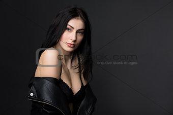 Beautiful brunnette model woman posing in studio