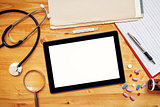 Tablet computer with blank screen on doctor's office desk