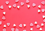 Festive red background and sweet sugar hearts, valentines day