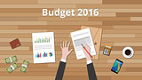 budget 2016 illustration with hand business man work on wooden table with graph and chart and paper document with money